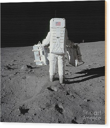 Astronaut Carrying Equipment Wood Print by Stocktrek Images