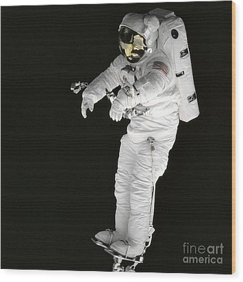 Astronaut Stands On A Portable Foot Wood Print by Stocktrek Images