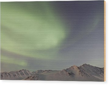 Auroras Over Mountains Wood Print by Tim Grams