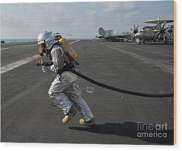 Aviation Boatswain's Mate Carries Wood Print by Stocktrek Images
