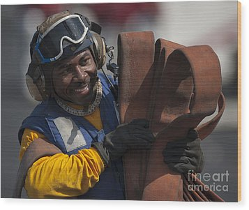 Aviation Boatswains Mate  Carrying Wood Print by Stocktrek Images