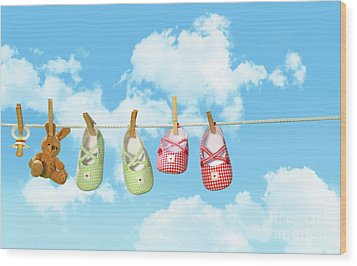 Baby Shoesr And Teddy Bear On Clothline Wood Print by Sandra Cunningham