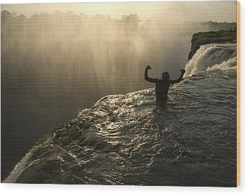Bathing In A Swimming Hole At The Top Wood Print by Annie Griffiths