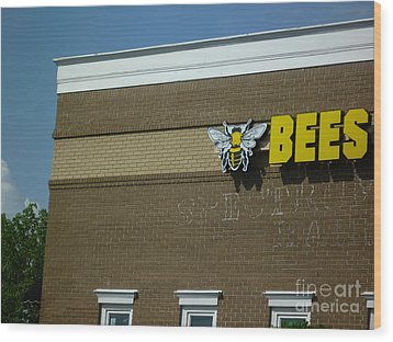 Wood Print featuring the photograph Bees On Building by Renee Trenholm