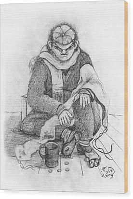 Beggar 2  In The  Winter Street Sitting On Floor Wearing Worn Out Cloths Wood Print by Rachel Hershkovitz