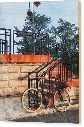 Bicycle By Train Station Wood Print by Susan Savad