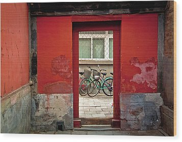 Bicycles In Red Doorway Wood Print by photo by Sharon Drummond