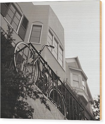 Bike Locked On Fence Against House Wood Print by Copyright Ricky G. Brown 2011