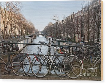 Wood Print featuring the digital art Bikes On The Canal In Amsterdam by Carol Ailles
