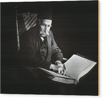 Blind Man Reading A Braille Book, Ca Wood Print by Everett