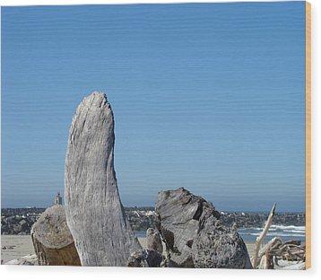 Blue Sky Coastal Landscape Driftwood Rock Pier Wood Print by Baslee Troutman