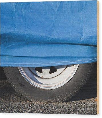 Blue Tarp And Car Wheel Wood Print by Paul Edmondson