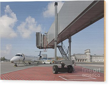 Boarding Bridge Leading To A Parked Plane Wood Print by Jaak Nilson