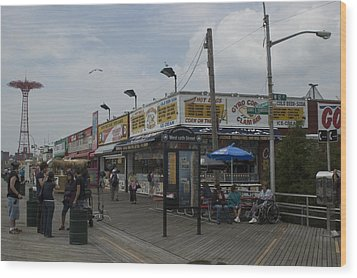 Boardwalk At Coney Island On A Cloudy Wood Print by Todd Gipstein