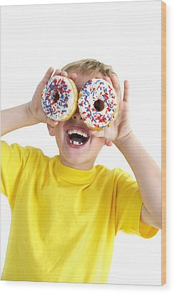 Boy Playing With Doughnuts Wood Print by Ian Boddy
