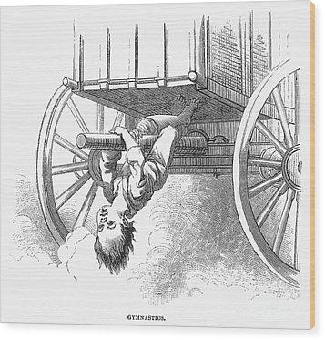 Boy Riding Under Wagon Wood Print by Granger