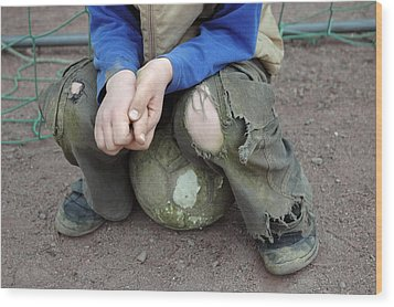 Boy Sitting On Ball - Torn Trousers Wood Print by Matthias Hauser