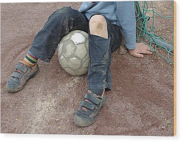 Boy With Soccer Ball Sitting On Dirty Field Wood Print by Matthias Hauser