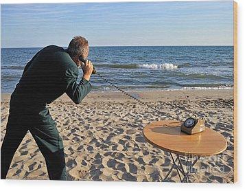 Businessman On Beach With Landline Phone Wood Print by Sami Sarkis