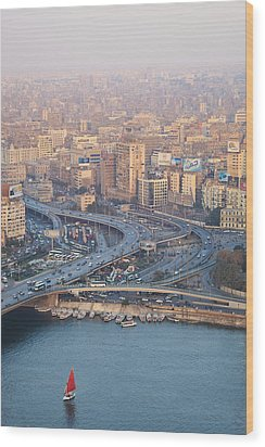 Busy Junction And The Nile With Traditional Boat Wood Print by Kokoroimages.com