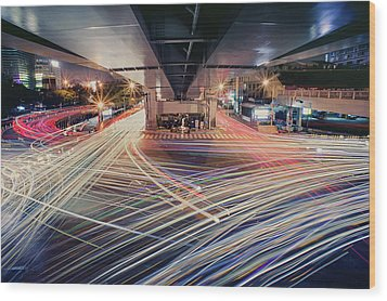 Busy Light Trail In City At Night Wood Print by Yiu Yu Hoi