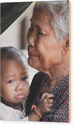 Wood Print featuring the photograph Cambodian Grandmother And Baby #1 by Nola Lee Kelsey