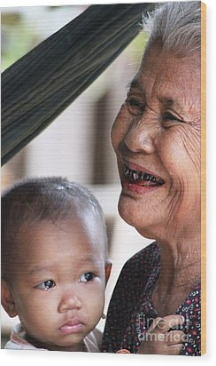 Wood Print featuring the photograph Cambodian Grandmother And Baby #2 by Nola Lee Kelsey