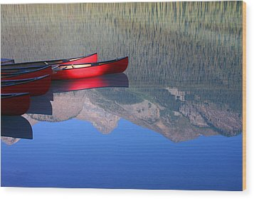 Canoes In The Rockies Wood Print by Steve Parr