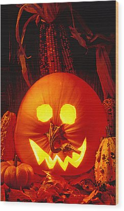 Carved Pumpkin With Fall Leaves Wood Print by Garry Gay