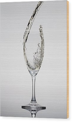 Champagne Being Poured Into A Glass Wood Print by Dual Dual