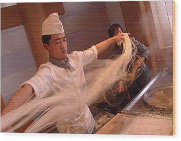 Chef Stretches Dough As He Makes Fresh Wood Print by Richard Nowitz