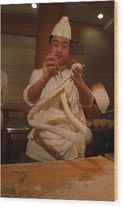 Chef Twirls Dough As He Makes Fresh Wood Print by Richard Nowitz