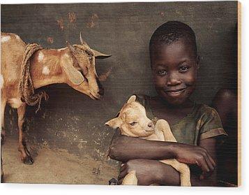 Child Holding A Kid Wood Print by Mauro Fermariello