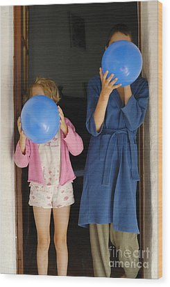 Children Blowing Up Balloons Wood Print by Sami Sarkis