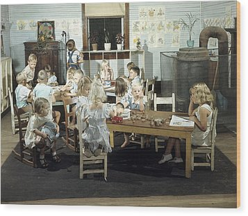 Children Play In A Day Nursery Wood Print by J Baylor Roberts