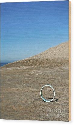 Circular Object On Beach Wood Print by Eddy Joaquim