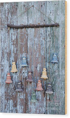 Clay Bells On A Weathered Door Wood Print by Jeremy Woodhouse