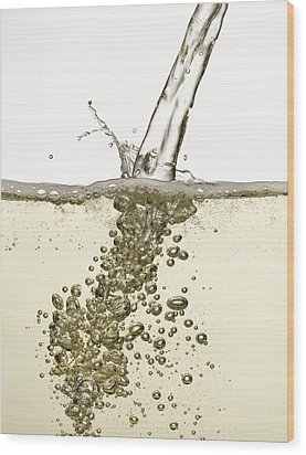 Close Up Of Champagne Being Poured Wood Print by Andy Roberts