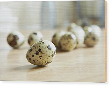 Close Up Of Quail Eggs On Counter Wood Print by Debby Lewis-Harrison