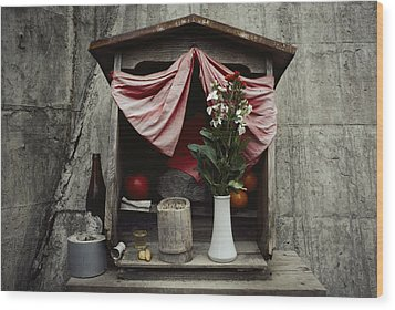 Close View Of A Shrine With Oferings Wood Print by Sam Abell
