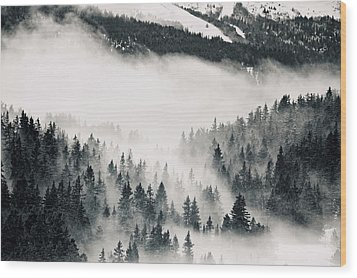 Clouds Moving Through Forest In French Alps Wood Print by Philipp Klinger