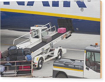 Conveyor Unloading Luggage Wood Print by Jaak Nilson