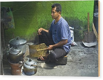 Cooking Wood Print by Charuhas Images