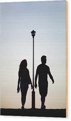 Couple Exercise While Walking At Sunset Wood Print by Virginia Star