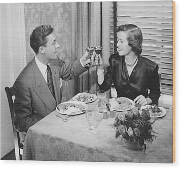 Couple Toasting At Dinner Table, (b&w), Elevated View Wood Print by George Marks