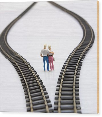 Couple Two Figurines Between Two Tracks Leading Into Different Directions Symbolic Image For Making Decisions Wood Print by Bernard Jaubert