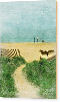 Couple Walking Dog On Beach Wood Print by Jill Battaglia