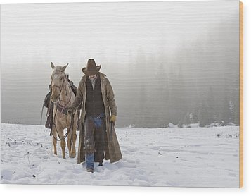 Cowboy Walking His Horse And Holding A Shotgun Wood Print by Thomas Kokta