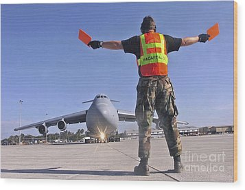 Crew Chief Marshals A C-5 Galaxy Wood Print by Stocktrek Images