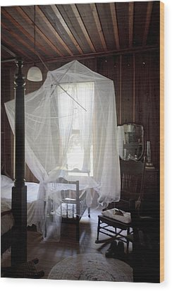 Crib With Mosquito Netting In A Florida Cracker Farmhouse Wood Print by Lynn Palmer